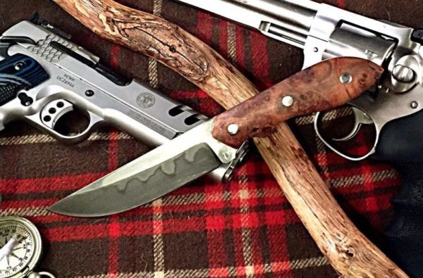 Eric Pearson makes a drop-point skinner with 1095 steel with hamon.